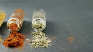 Various spices spilled out of jar 4k