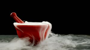 Ice smoke in mortar and pestle against black background 4k