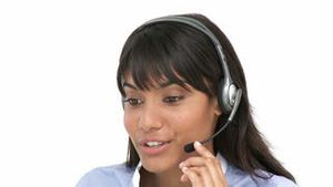 Smiling business woman using headset