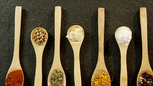 Various spices arranged in a spoon 4k