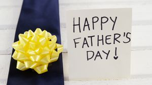 Floral ribbon with fathers day message 4k