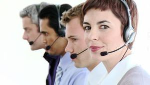 Positive business people in a call center