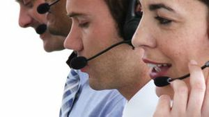 Concentrated business people working in a callcenter