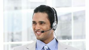 Ethnic Business man using a headset