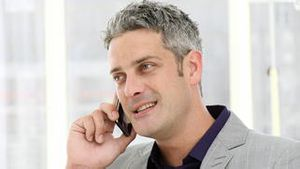 Lucky businessman talking on phone