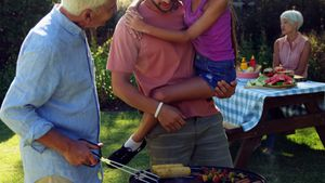 Happy girl, father and grandfather preparing barbecue 4k