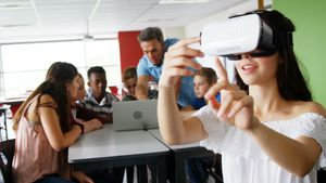 Schoolgirl using virtual reality headset 4k