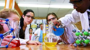 Schoolkids experimenting chemical in laboratory 4k