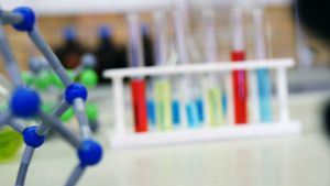 Close-up of molecule model and chemicals on table 4k