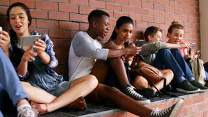 Group of school friends using mobile phone 4k