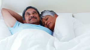 Senior couple relaxing in bedroom 4k