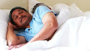 Senior man getting disturbed with woman snoring on bed 4k