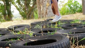 Fit people practicing tire obstacle course training 4k