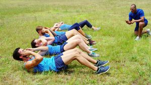 Fit people performing crunches exercise 4k