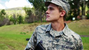 Air force soldier guarding with a rifle 4k