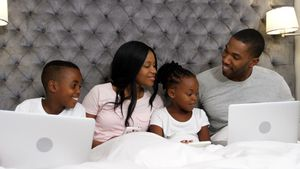 Family using electronic devices in bedroom 4k