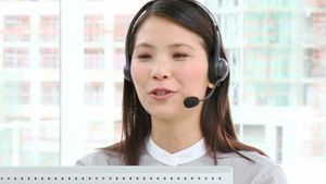 Asian businesswoman with headset on