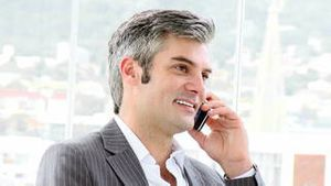 Mature businessman calling by phone