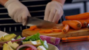 Chef chopping carrot in commercial kitchen 4k