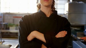 Female chef standing in the commercial kitchen 4k