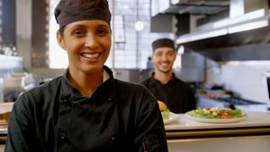 Female chef smiling in commercial kitchen 4k