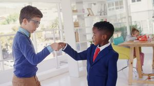 Kids as business executives shaking hands 4k