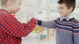 Kids as business executives shaking hands, 4k