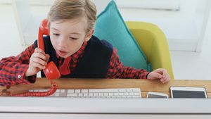 Boy as business executive talking on the phone 4k