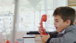Boy as business executive screaming on phone 4k