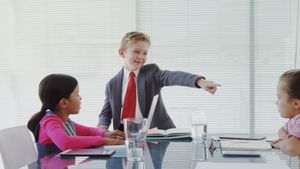 Kids as business executives having a meeting in the board room 4k