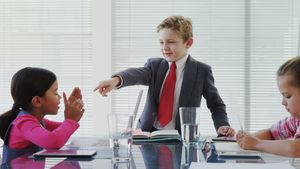 Kids as business executives having a meeting in the board room 4K 4k