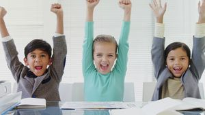 Kids as business executive smiling with their arms up 4k
