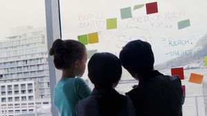 Kids as business executives discussing over whiteboard 4k