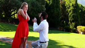 Man proposing a woman with a ring on his knee 4k