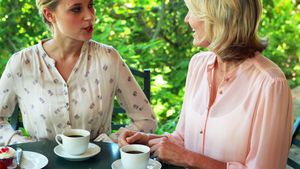 Female friends having coffee together 4k