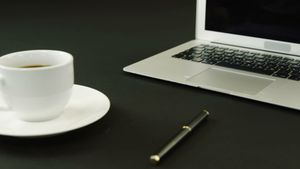 Laptop, coffee and pen on black background 4k