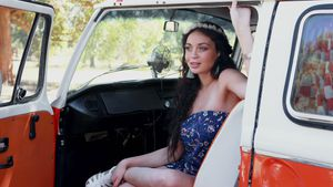 Woman relaxing in camper van 4k