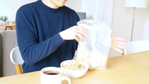 Man pouring breakfast cereal into bowl 4k