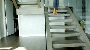 Woman with yoga mat walking down on stair case 4k