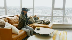 Woman using virtual reality headset in living room 4k