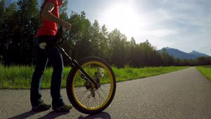 Woman passing through the road with unicycle 4k