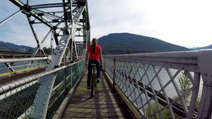 Woman riding unicycle on the bridge 4k