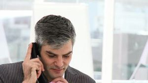 Confident businessman talking on phone