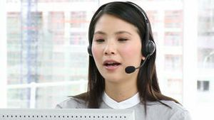 Asian executive with headset on