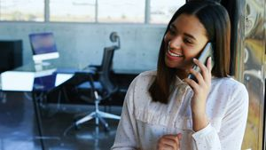 Happy executive talking on mobile phone 4k