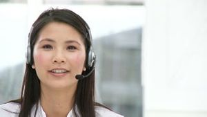 Asian customer agent with headset on