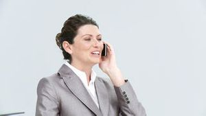 Female executive calling by phone
