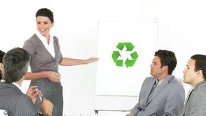 Female executive presenting the concept of recycling