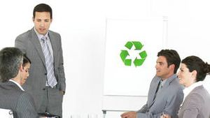 Confident businessman presenting the concept of recycling