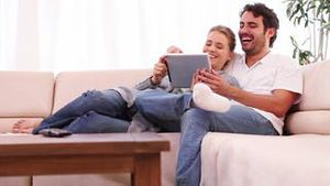 Young couple holding a tablet computer